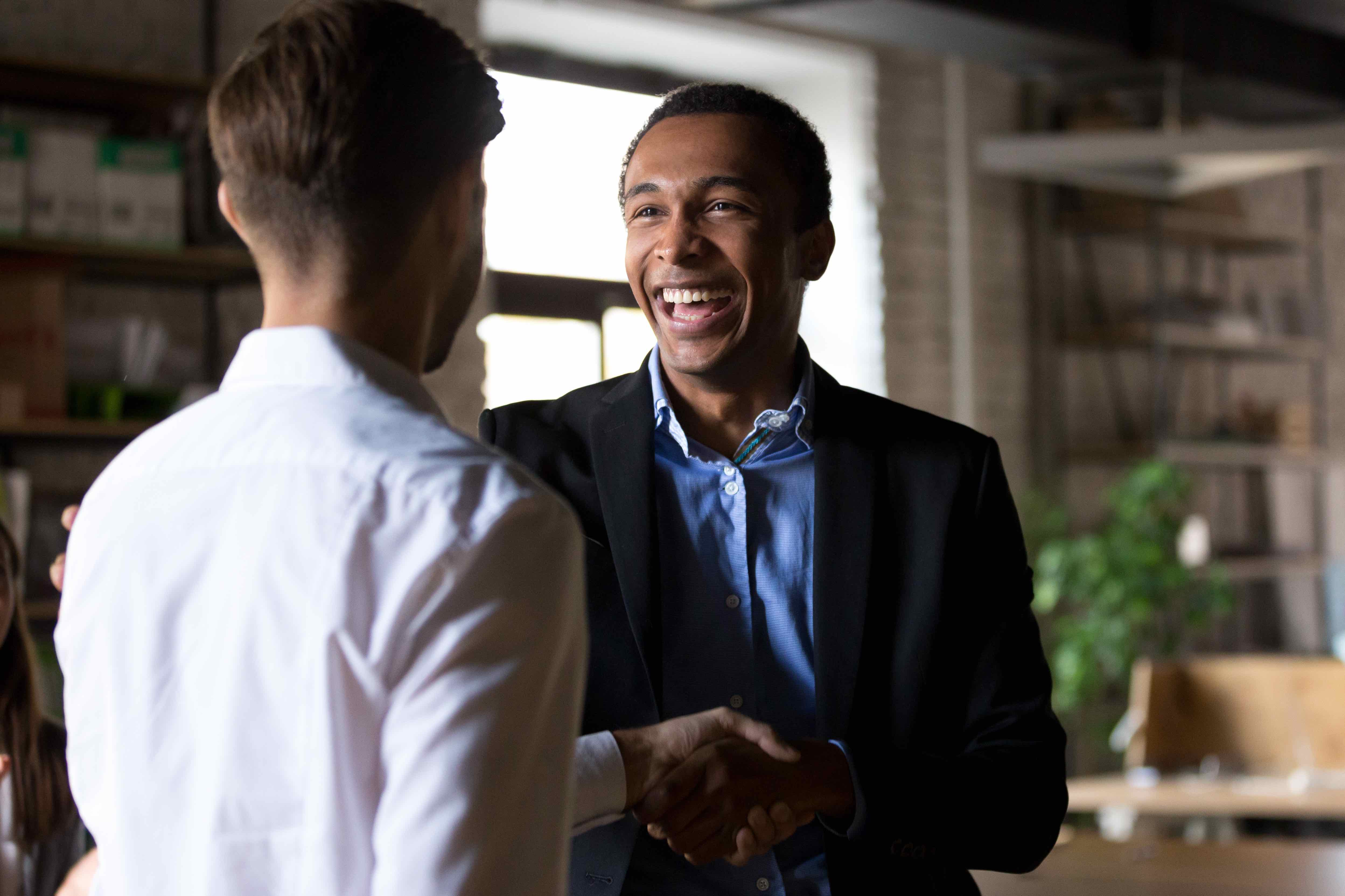 Account manager shaking hands with client